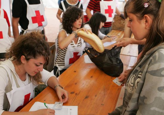 Red cross volunteers giving aid